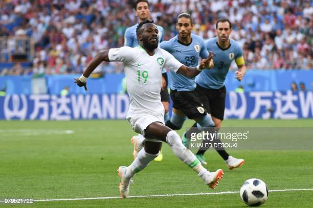 Saudi Arabia's forward Fahad AlMuwallad runs with the ball during the Russia 2018 World Cup Group A football match between Uruguay and Saudi Arabia...