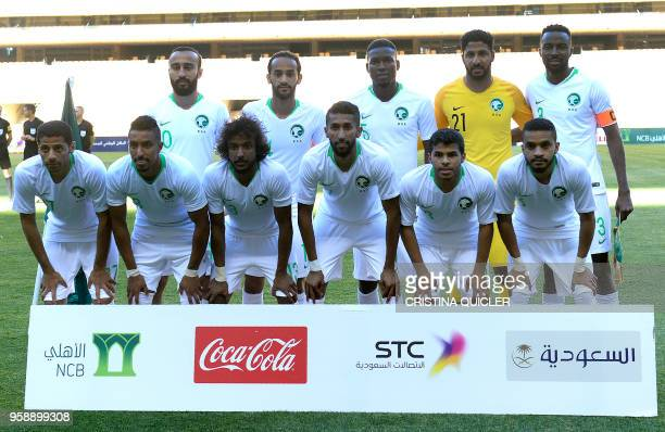 Saudi Arabia's forward Mohammad AlSahlawi Saudi Arabia's midfielder Abdullah Otayf Saudi Arabia's defender Omar Hawsawi Saudi Arabia's goalkeeper...
