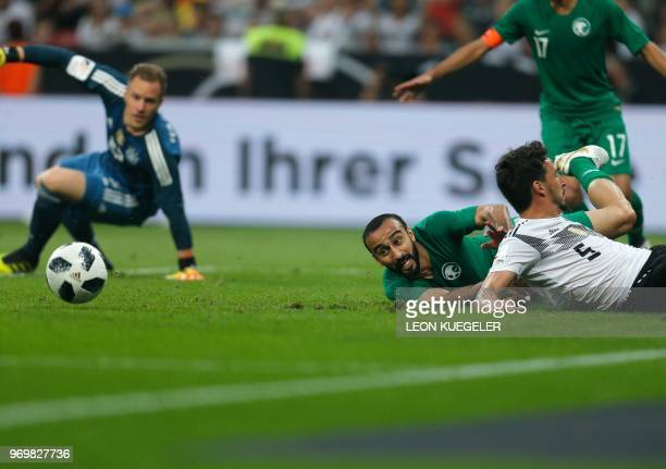 Saudi Arabia's forward Mohammad AlSahlawi vies with Germany's defender Mats Hummels during the international friendly football match between Germany...