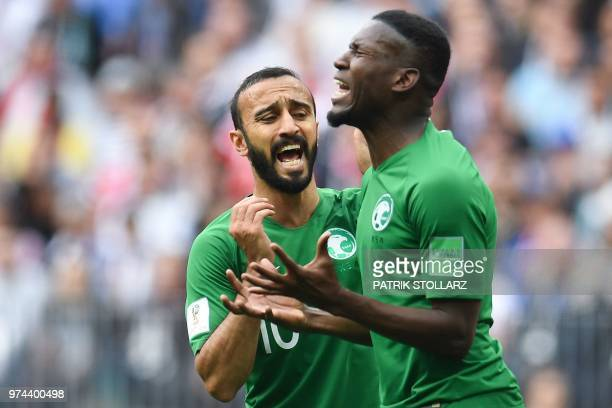 Saudi Arabia's forward Mohammed AlSahlawi and Saudi Arabia's defender Omar Hawsawi react after missing a goal opportunity during the Russia 2018...