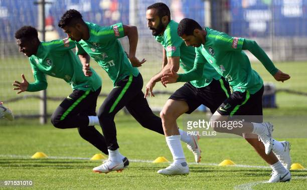 Saudi Arabia's forward Mohammed AlSahlawi runs during a training session in Saint Petersburg on June 11 ahead of the Russia 2018 World Cup football...