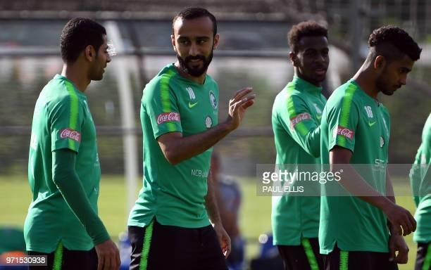 Saudi Arabia's forward Mohammed AlSahlawi talks to Saudi Arabia's midfielder Taiseer Al Jassam during a training session in Saint Petersburg on June...