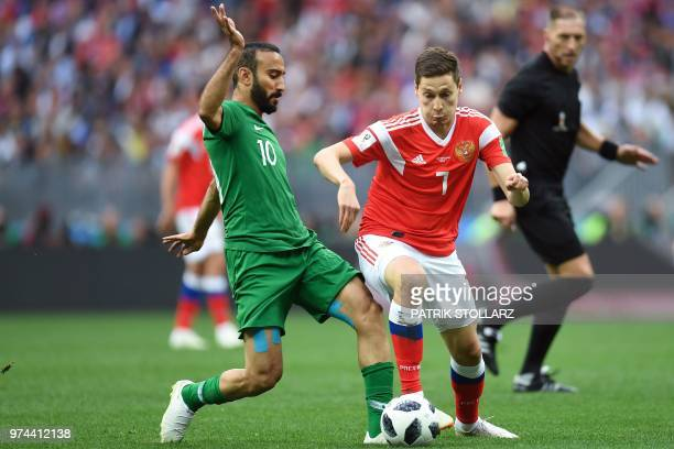 Saudi Arabia's forward Mohammed AlSahlawi vies with Russia's midfielder Daler Kuzyaev during the Russia 2018 World Cup Group A football match between...