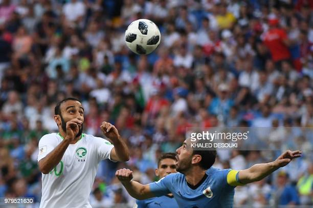 Saudi Arabia's forward Mohammed AlSahlawi vies with Uruguay's defender Diego Godin during the Russia 2018 World Cup Group A football match between...