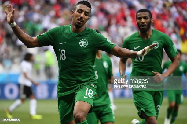 TOPSHOT Saudi Arabia's forward Salem AlDawsari celebrates scoring during the Russia 2018 World Cup Group A football match between Saudi Arabia and...