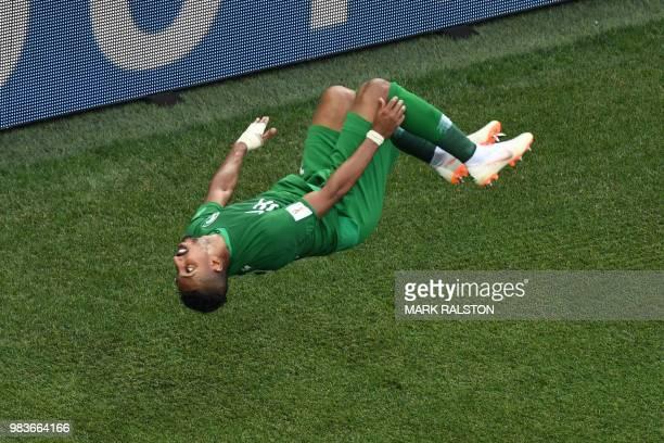 TOPSHOT Saudi Arabia's forward Salem AlDawsari celebrates scoring his team's winning goal during the Russia 2018 World Cup Group A football match...