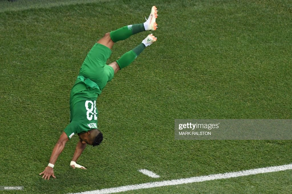 TOPSHOT - Saudi Arabia's forward Salem Al-Dawsari celebrates scoring his team's winning goal during the Russia 2018 World Cup Group A football match between Saudi Arabia and Egypt at the Volgograd Arena in Volgograd on June 25, 2018. (Photo by Mark RALSTON / AFP) / RESTRICTED