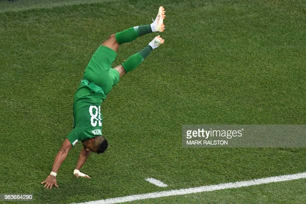 TOPSHOT Saudi Arabia's forward Salem AlDawsari celebrates scoring his team's winning goal during the Russia 2018 World Cup Group A football match...