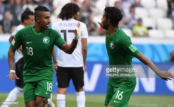 Saudi Arabia's forward Salem AlDawsari is congratulated by midfielder Hussain Al Moqahwi after scoring during the Russia 2018 World Cup Group A...