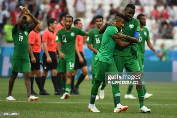 Saudi Arabia's forward Salem AlDawsari is hugged by defender Osama Hawsawi after the Russia 2018 World Cup Group A football match between Saudi...