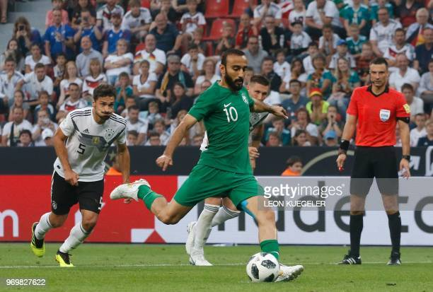 Saudi Arabia's foward Mohammad AlSahlawi attempts to score a penalty during the international friendly football match between Germany and Saudi...