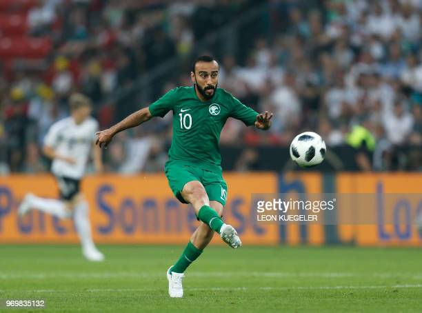 Saudi Arabia's foward Mohammad AlSahlawi plays the ball during the international friendly football match between Germany and Saudi Arabia at the...