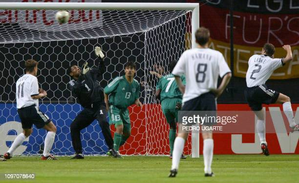 Saudi Arabia's goalie Mohammed Al Deayea watches the ball go into the net after Germany's defender Thomas Linke struck to score his team's sixth goal...