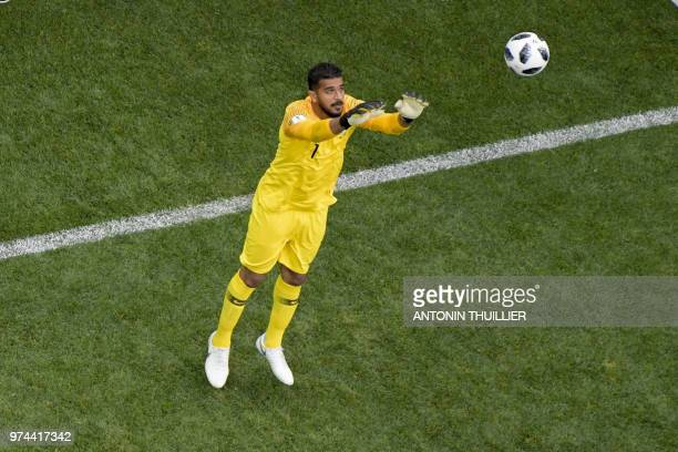 Saudi Arabia's goalkeeper Abdullah AlMayouf catches the ball during the Russia 2018 World Cup Group A football match between Russia and Saudi Arabia...