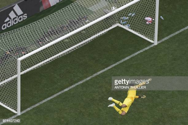 Saudi Arabia's goalkeeper Abdullah AlMayouf fails to stop a goal by Russia's midfielder Denis Cheryshev during the Russia 2018 World Cup Group A...