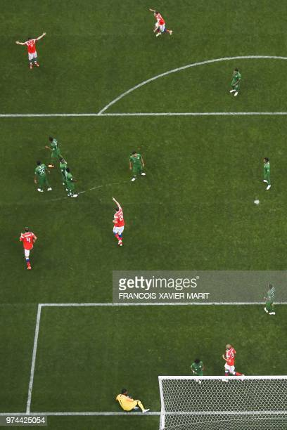 Saudi Arabia's goalkeeper Abdullah AlMayouf fails to stop a goal by Russia's midfielder Aleksandr Golovin during the Russia 2018 World Cup Group A...