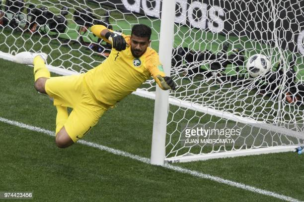 TOPSHOT Saudi Arabia's goalkeeper Abdullah AlMayouf fails to stop a goal during the Russia 2018 World Cup Group A football match between Russia and...