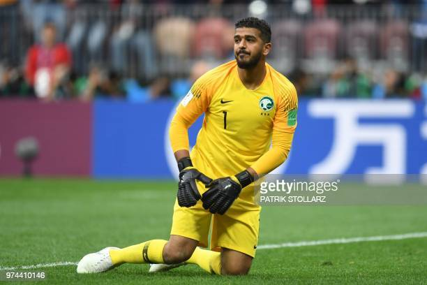 Saudi Arabia's goalkeeper Abdullah AlMayouf kneels on the field during the Russia 2018 World Cup Group A football match between Russia and Saudi...