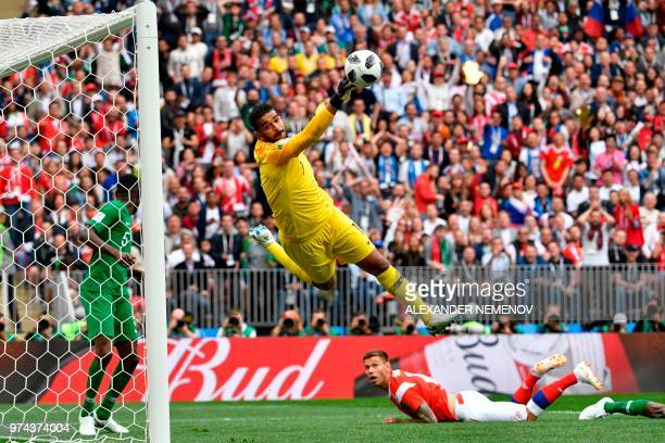 TOPSHOT Saudi Arabia's goalkeeper Abdullah AlMayouf makes a save during the Russia 2018 World Cup Group A football match between Russia and Saudi...