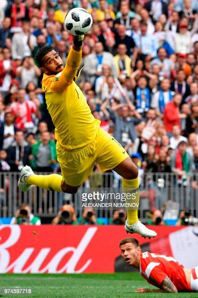 Saudi Arabia's goalkeeper Abdullah AlMayouf makes a save during the Russia 2018 World Cup Group A football match between Russia and Saudi Arabia at...
