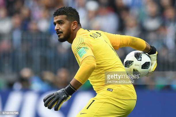 Saudi Arabia's goalkeeper Abdullah AlMayouf prepares to throw the ball during the Russia 2018 World Cup Group A football match between Russia and...