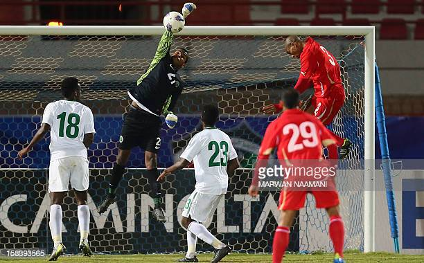 Saudi Arabia's goalkeeper Fawaz alKhaibari blocks Bahrain's Abdullah Marzuq header during their match in the 7th West Asia Football Federation...