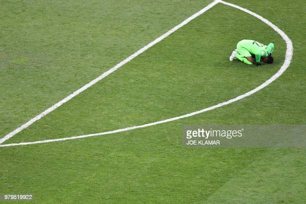 TOPSHOT Saudi Arabia's goalkeeper Mohammed AlOwais reacts at the end of the Russia 2018 World Cup Group A football match between Uruguay and Saudi...