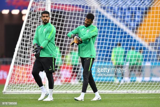Saudi Arabia's goalkeepers Abdullah AlMayouf and Mohammed AlOwais take part in a training session at the Rostov Arena in RostovOnDon on June 19 on...