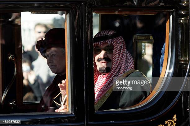 Saudi Arabia's King Abdullah bin Abdulaziz Al Saud right arrives at Buckingham Palace with Britain's Queen Elizabeth II in London UK on Tuesday Oct...
