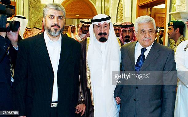 Saudi Arabia's King Abdullah walks with Palestinian President Mahmoud Abbas and Hamas leader Khaled Meshaal following peace talks on February 8 2007...