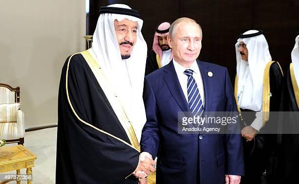 Saudi Arabia's King Salman bin Abdulaziz Al Saud and Russia's President Vladimir Putin shake hands as they meet on the sidelines of the G20 summit in...