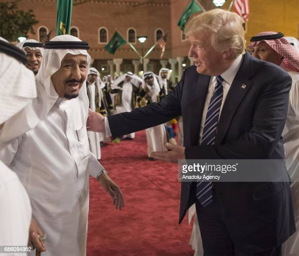 Saudi Arabia's King Salman bin Abdulaziz Al Saud welcomes US President Donald Trump ahead of a dinner given in honour of him at Murabba Palace in...