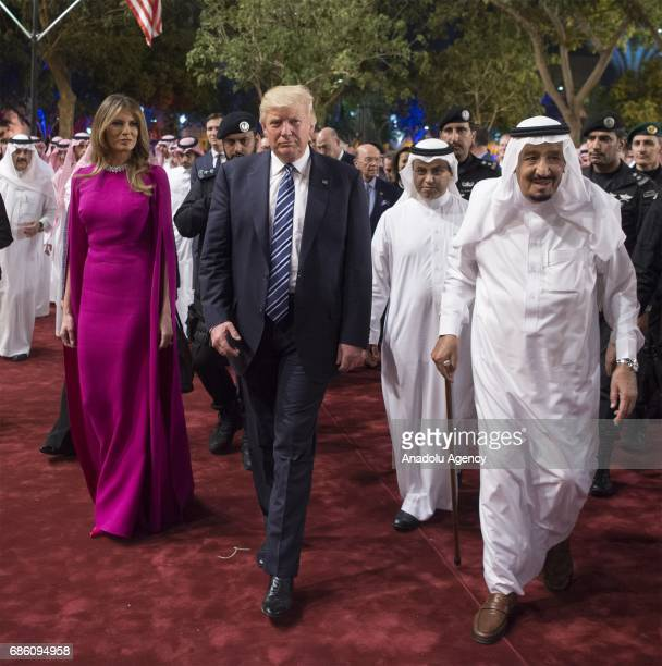Saudi Arabia's King Salman bin Abdulaziz Al Saud welcomes US President Donald Trump and First Lady Melania Trump ahead of a dinner given in honour of...