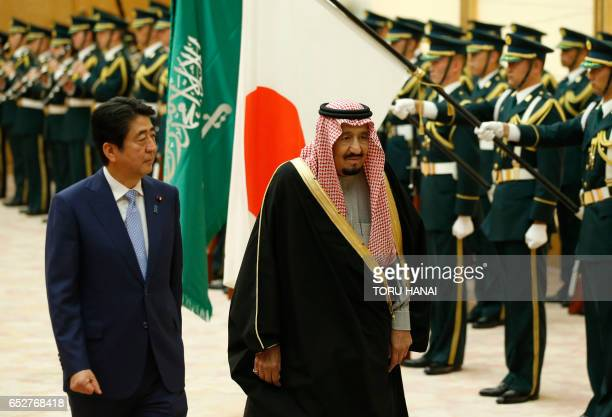 Saudi Arabia's King Salman bin Abdulaziz alSaud and Japan's Prime Minister Shinzo Abe review an honour guard before their meeting at Abe's official...