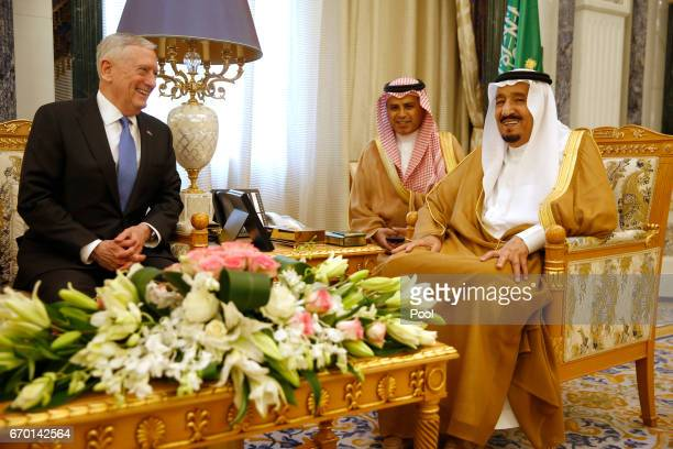 Saudi Arabia's King Salman bin Abdulaziz AlSaud flanked by an interpreter welcomes US Defense Secretary James Mattis on April 19 2017 in Riyadh Saudi...