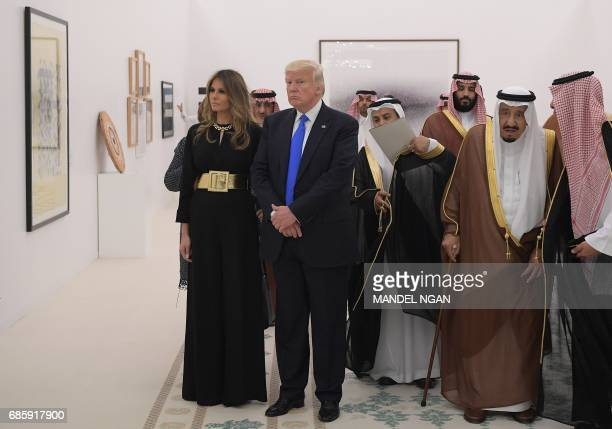Saudi Arabia's King Salman bin Abdulaziz alSaud US President Donald Trump and US First Lady Melania Trump look at a display of Saudi modern art at...