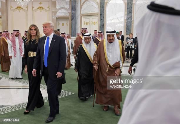 Saudi Arabia's King Salman bin Abdulaziz alSaud US President Donald Trump and US First Lady Melania Trump make their way into a gallery to see a...