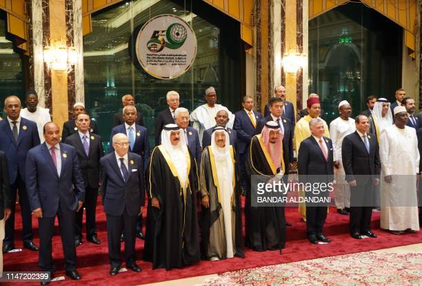 Saudi Arabia's King Salman bin Abdulaziz poses for a family picture with OIC heads of state and officials at the opening of a summit of the 57-member...