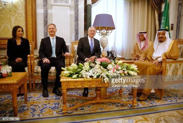 Saudi Arabia's King Salman welcomes US Defence Secretary James Mattis sitting next to White House Deputy National Security Advisor Dina Powell and US...