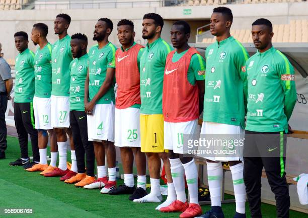 Saudi Arabia's midfielder Abdullah AlKhaibari Saudi Arabia's defender Saeed Al Mowalad Saudi Arabia's midfielder Mohamed Kanno Saudi Arabia's...