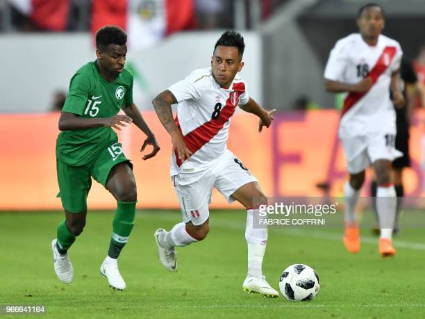 Saudi Arabia's midfielder Abdullah AlKhaibari vies with Peru's midfielder Christian Cueva during an international friendly football match between...