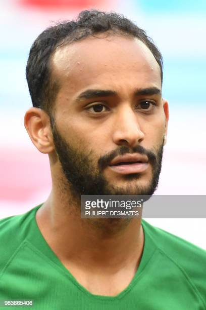 Saudi Arabia's midfielder Abdullah Otayf poses for a photo before the Russia 2018 World Cup Group A football match between Saudi Arabia and Egypt at...