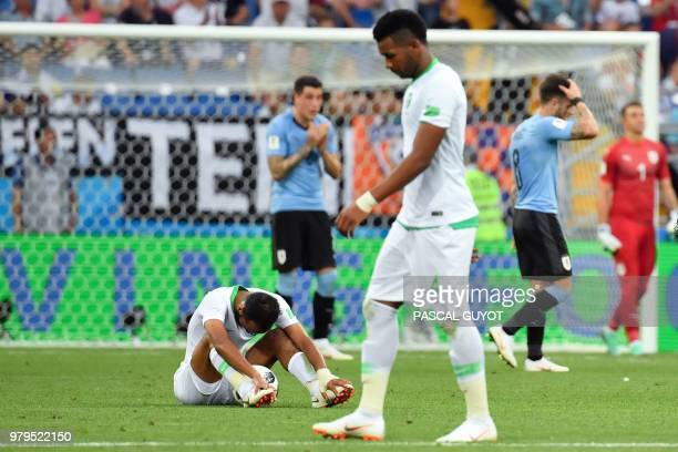 Saudi Arabia's midfielder Abdullah Otayf sits on the field at the end of the Russia 2018 World Cup Group A football match between Uruguay and Saudi...