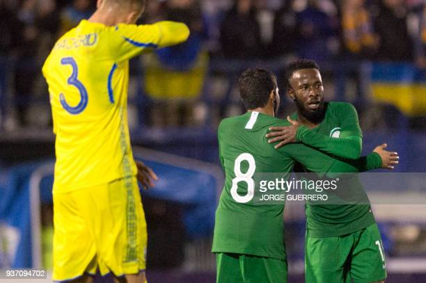 Saudi Arabia's midfielder Fahad alMuwallad celebrates with midfielder Yahya alShehri after scoring a goal during an international friendly football...