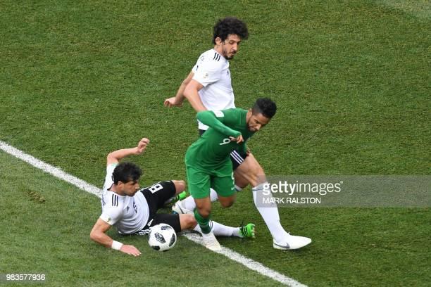 Saudi Arabia's midfielder Hatan Babhir is marked by Egypt's midfielder Tarek Hamed and Egypt's defender Ahmed Hegazi during the Russia 2018 World Cup...
