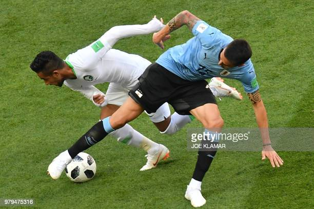 TOPSHOT Saudi Arabia's midfielder Hatan Babhir vies with Uruguay's midfielder Matias Vecino during the Russia 2018 World Cup Group A football match...