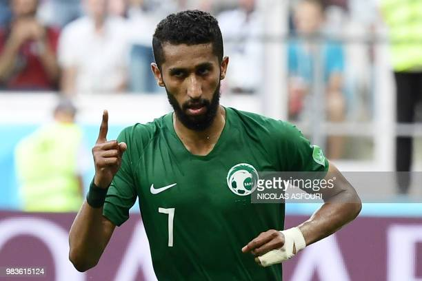 TOPSHOT Saudi Arabia's midfielder Salman AlFaraj celebrates scoring from the penalty spot during the Russia 2018 World Cup Group A football match...