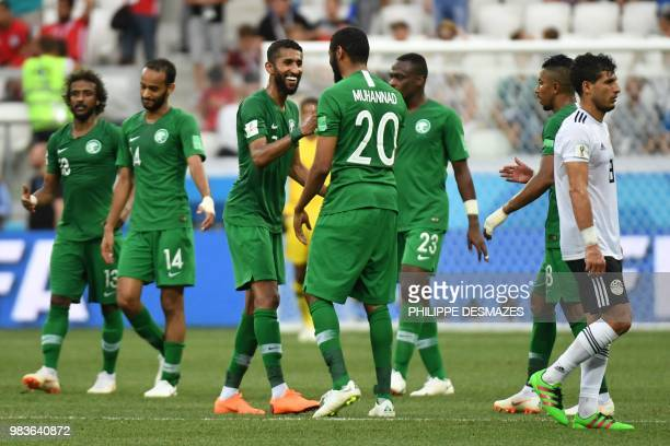 TOPSHOT Saudi Arabia's midfielder Salman AlFaraj celebrates with forward Mohannad Assiri after forward Salem AlDawsari scored during the Russia 2018...