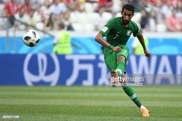 Saudi Arabia's midfielder Salman AlFaraj kicks the ball during the Russia 2018 World Cup Group A football match between Saudi Arabia and Egypt at the...