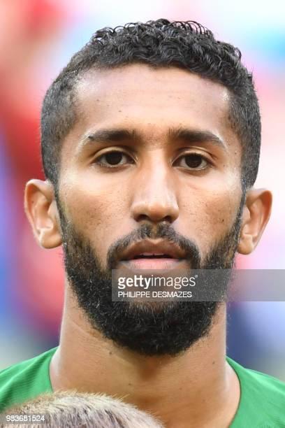 Saudi Arabia's midfielder Salman AlFaraj poses for a photo before the Russia 2018 World Cup Group A football match between Saudi Arabia and Egypt at...